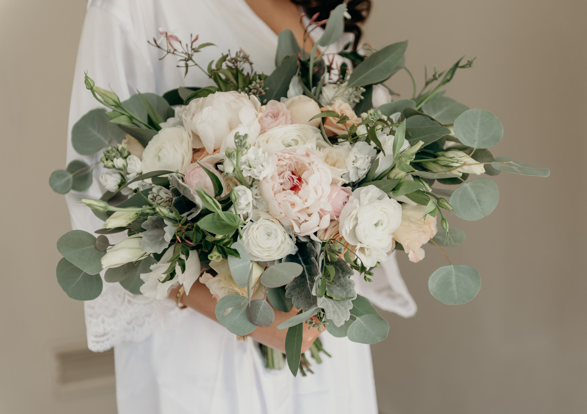 bride in robe with bouquet