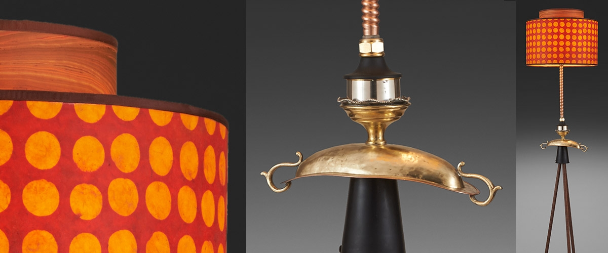 Lamp with orange and red shade by Susan Icove.