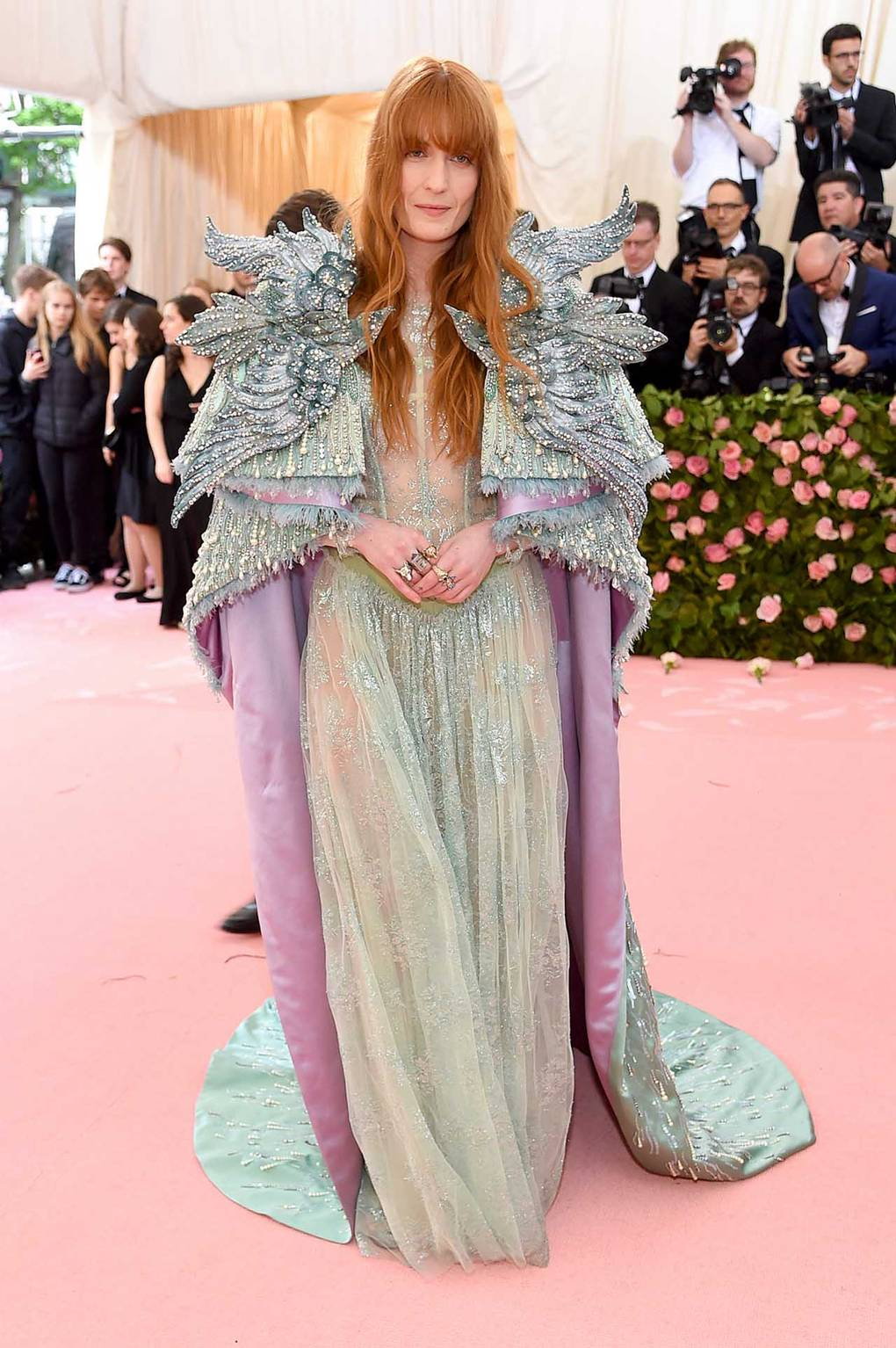 Florence Welch wearing Gucci - Statement shoulders was a big trend on this years pink carpet and Florence's cape did not disappoint. I'm a big fan of layers and structure and this cape designed bu Gucci's Alessandro Michele delivered for me! This Magical medieval-inspired turquoise and lilac beaded cape was perfectly matched with a sheer lace dress embellished with delicate jewels. BEAUTIFUL!