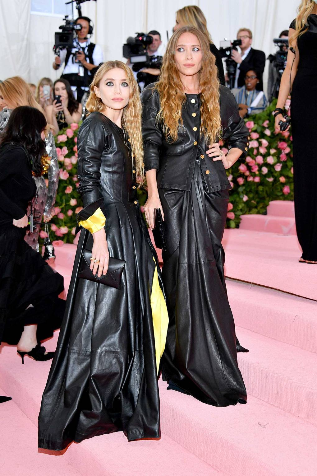 Mary-Kate and Ashley Olsen wearing vintage Chanel - Two looks not loved by many however the Olsen twins truly know fashion and always commit to styles that are technically interesting opposed to the latest trends. Yes i am a fan of The Row! I must say these are not looks I would or could wear however I have a huge appreciation for the girls pulling off this look in such a glamours and dare I say elegant way. I'm not a fan of the yellow satin lining however the pleating, cinched waists and controlled draping all incorporated into long-length leather dresses really screams camp in a whole different way!