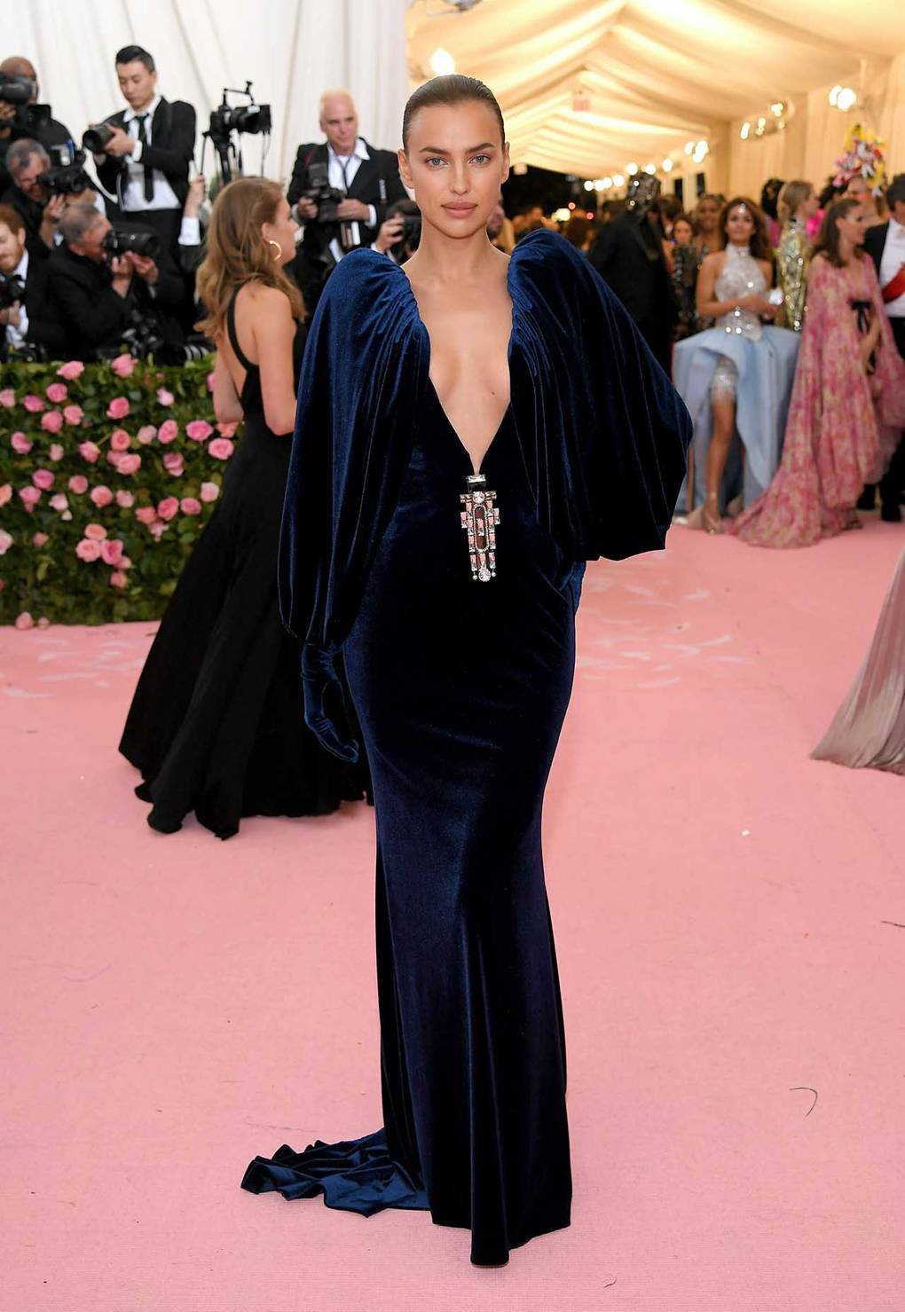 Irina Shayk wearing Burberry - Velvet dreams!!! So many velvet dresses have been made over the years, some beautiful other not so much! This gorgeous number including matching gloves has me going crazy, the rich blue, full sleeves, deep v neckline with art deco esque jewel to finish really makes me go wow. Understated camp which is so glam!