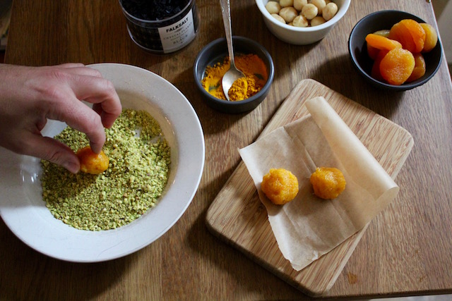 Rolling Apricot Bliss Balls in Pistachios