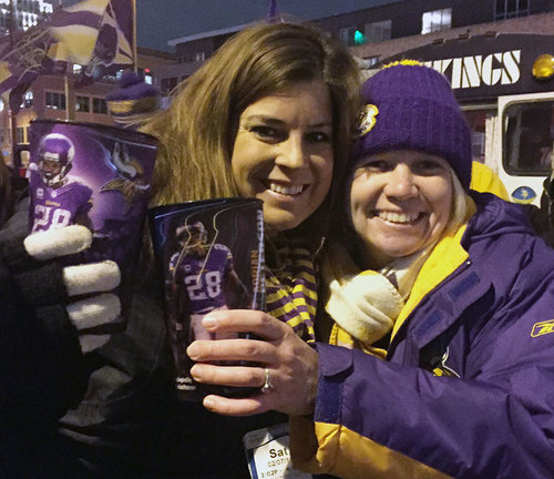 Vikings fans holding cups