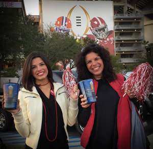 Fans holding National Championship Game Cup