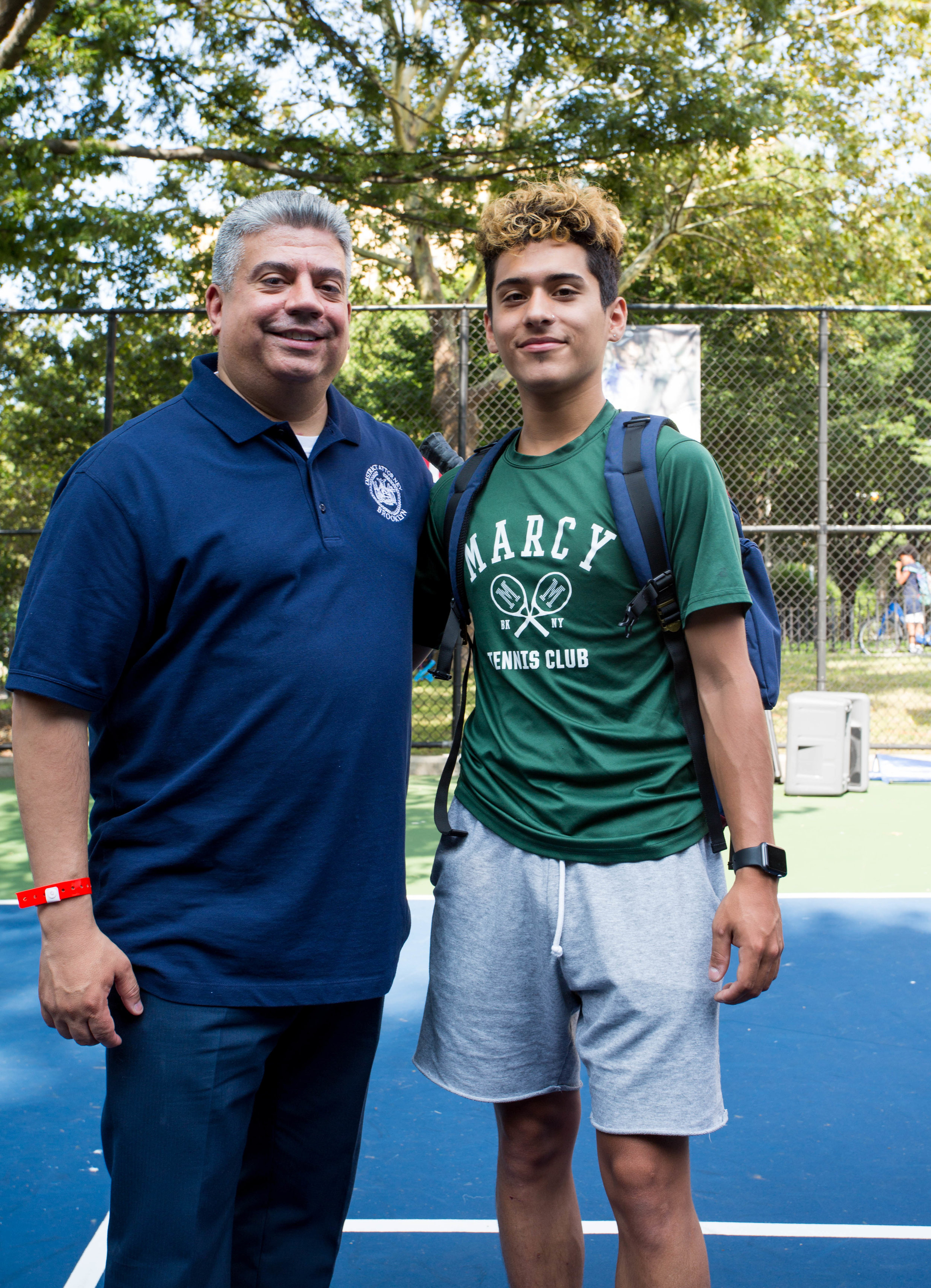 Brooklyn D.A. Eric Gonzalez and King's County Tennis League graduate, Brandon Otero.