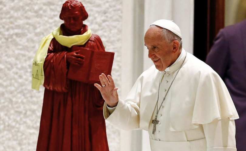Pope Francis appearing next to a statue of Martin Luther for an ecumenical event held with Lutherans at the Vatican   Photo from Lifesite News