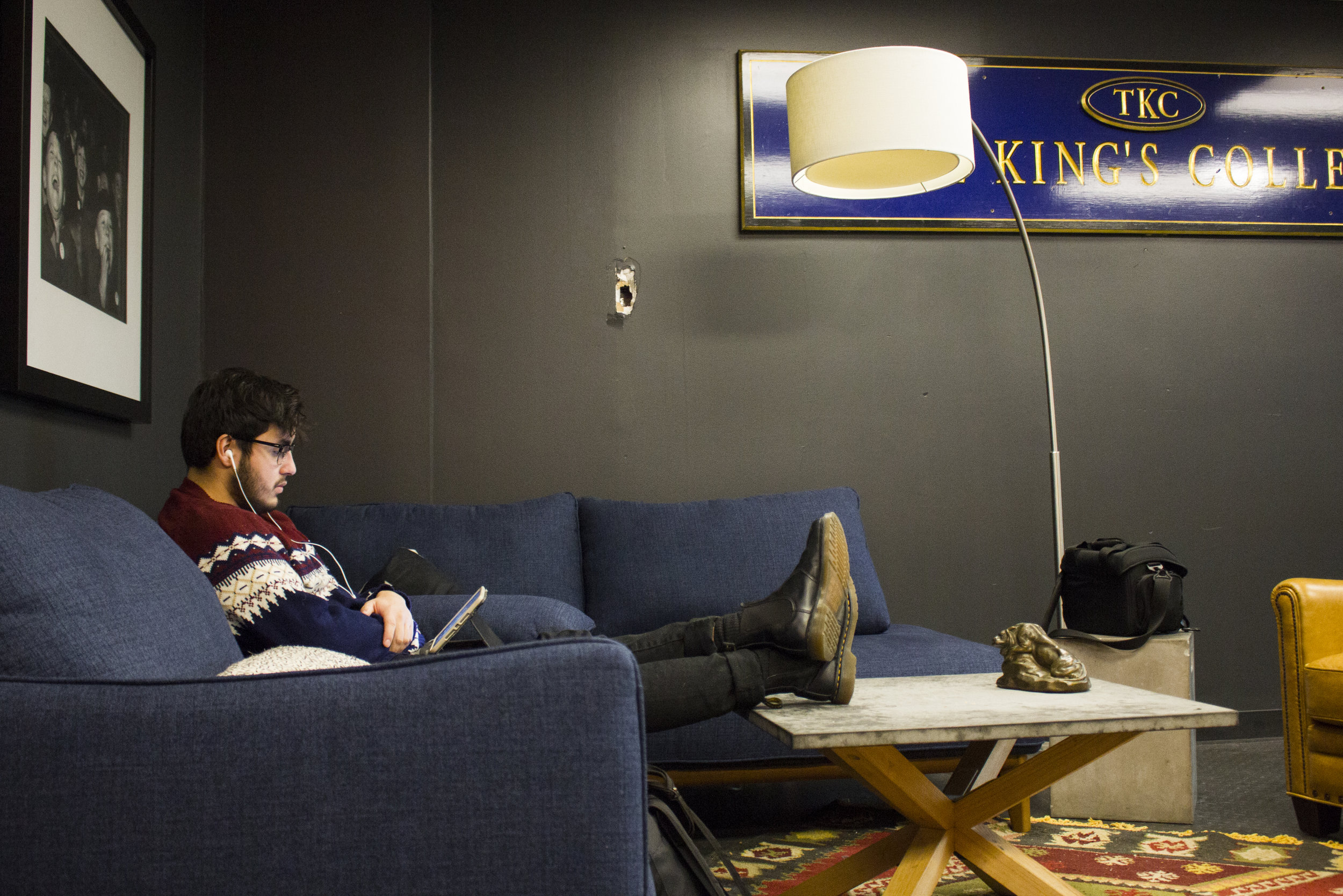 Stevie Hernandez relaxes on the new couch in the Lion's Den, located on the fifth floor | Photo by Bernadette Berdychowski