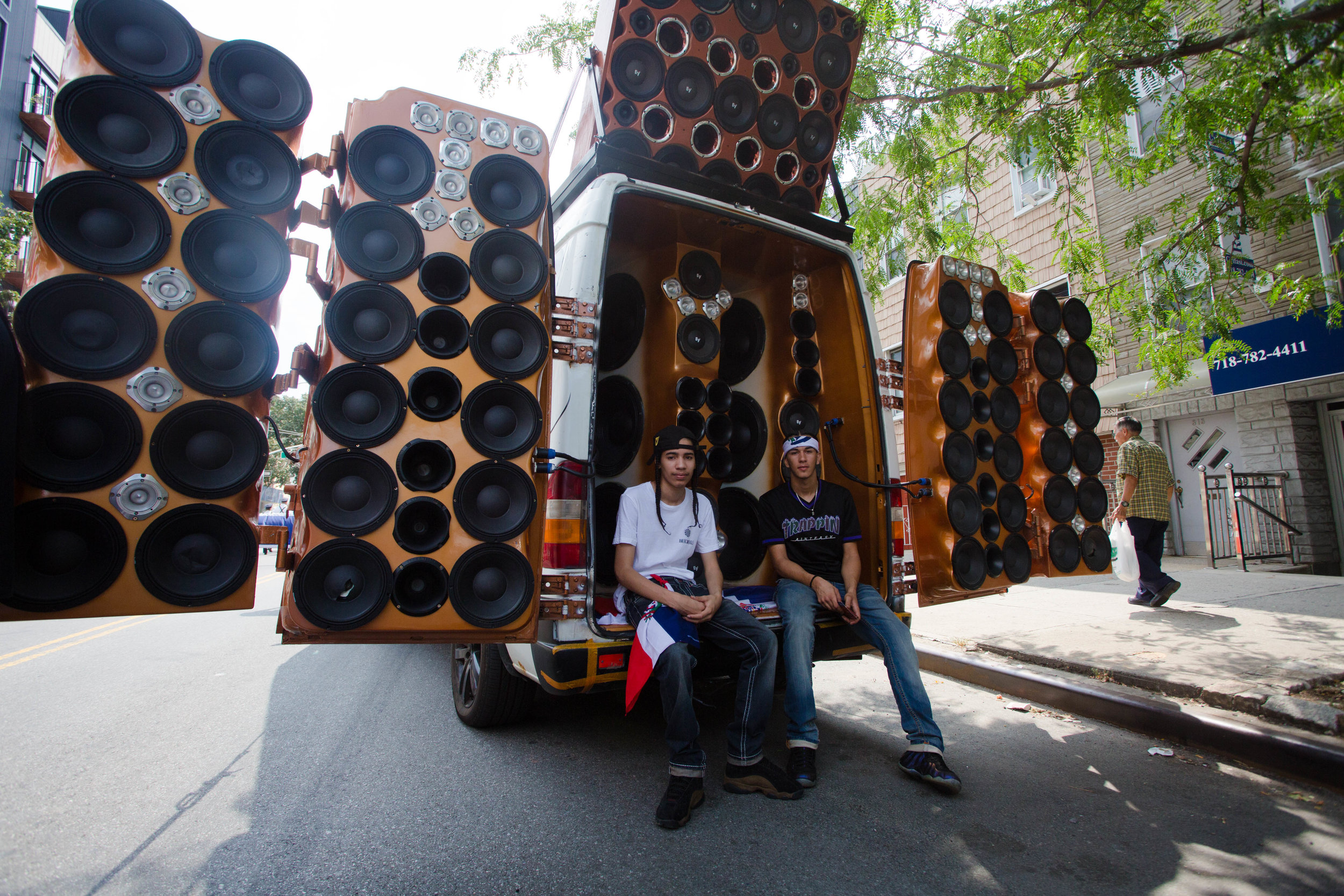 Hanser De la Rosa (left) and Bran Brahea (right) sitting on the back of an incredibly pimped out speaker system at the 18th annual Williamsburg Dominican Parade, on Sunday, Aug 26, in New York. Photo: Wes Parnell