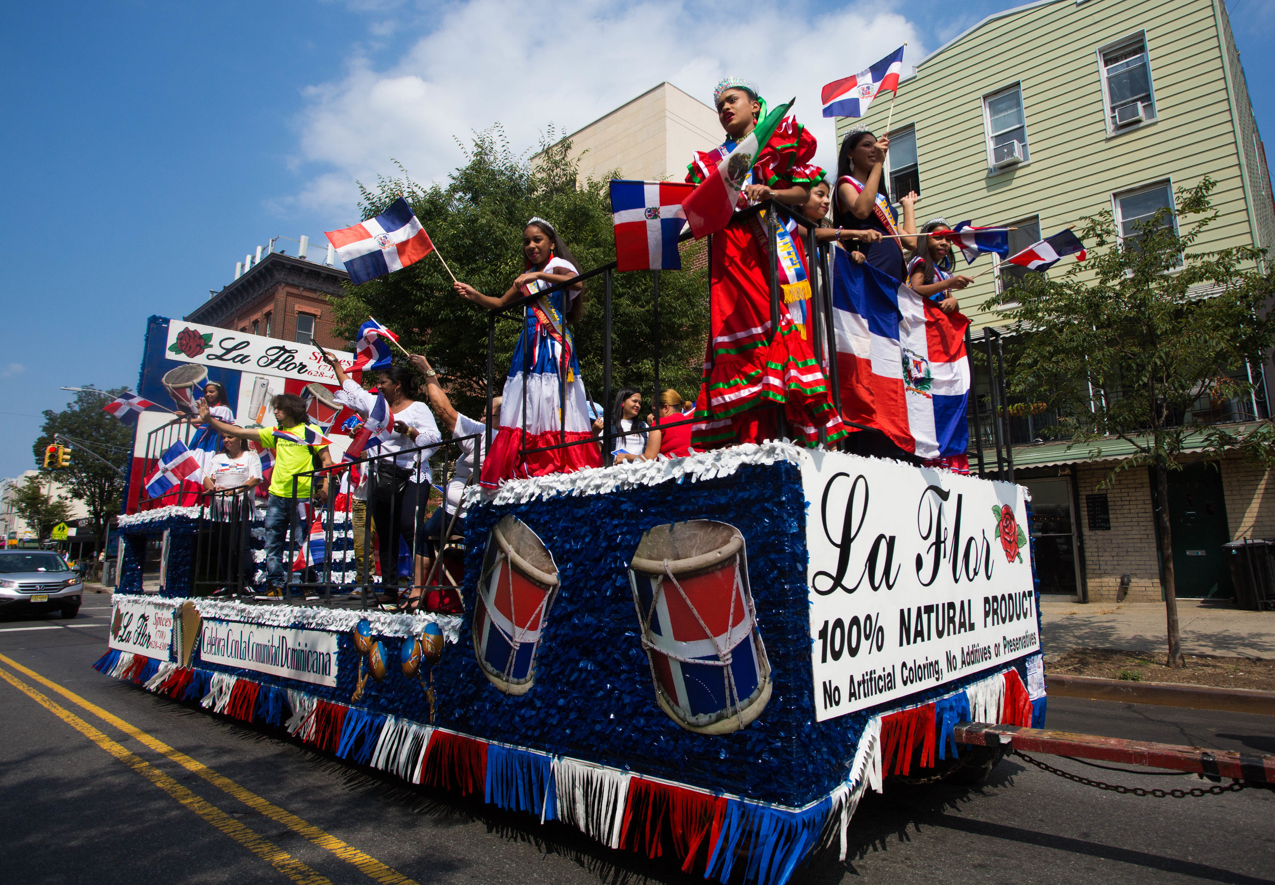 "The ""La Flor"" float carrying local beuty pageant winners and community members at the 18th annual Williamsburg Dominican Parade, on Sunday, Aug 26, in New York. Photo: Wes Parnell"