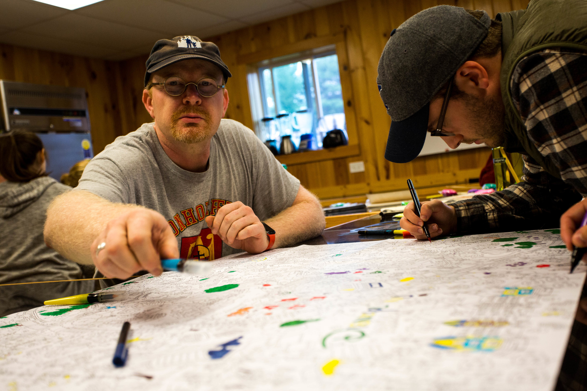 """Professor Steve Salyers """"Doc"""" takes time to color at fall retreat in Iroquois Springs, New York 