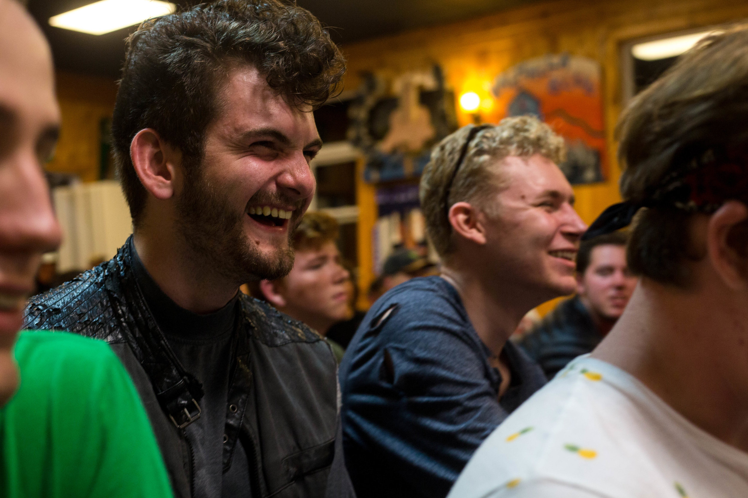 House of Bonhoeffer members Ryan Turner [left] and Meric Pope [right] laugh in response to a drama competition skit. || Photo Credit: Wesley Parnell