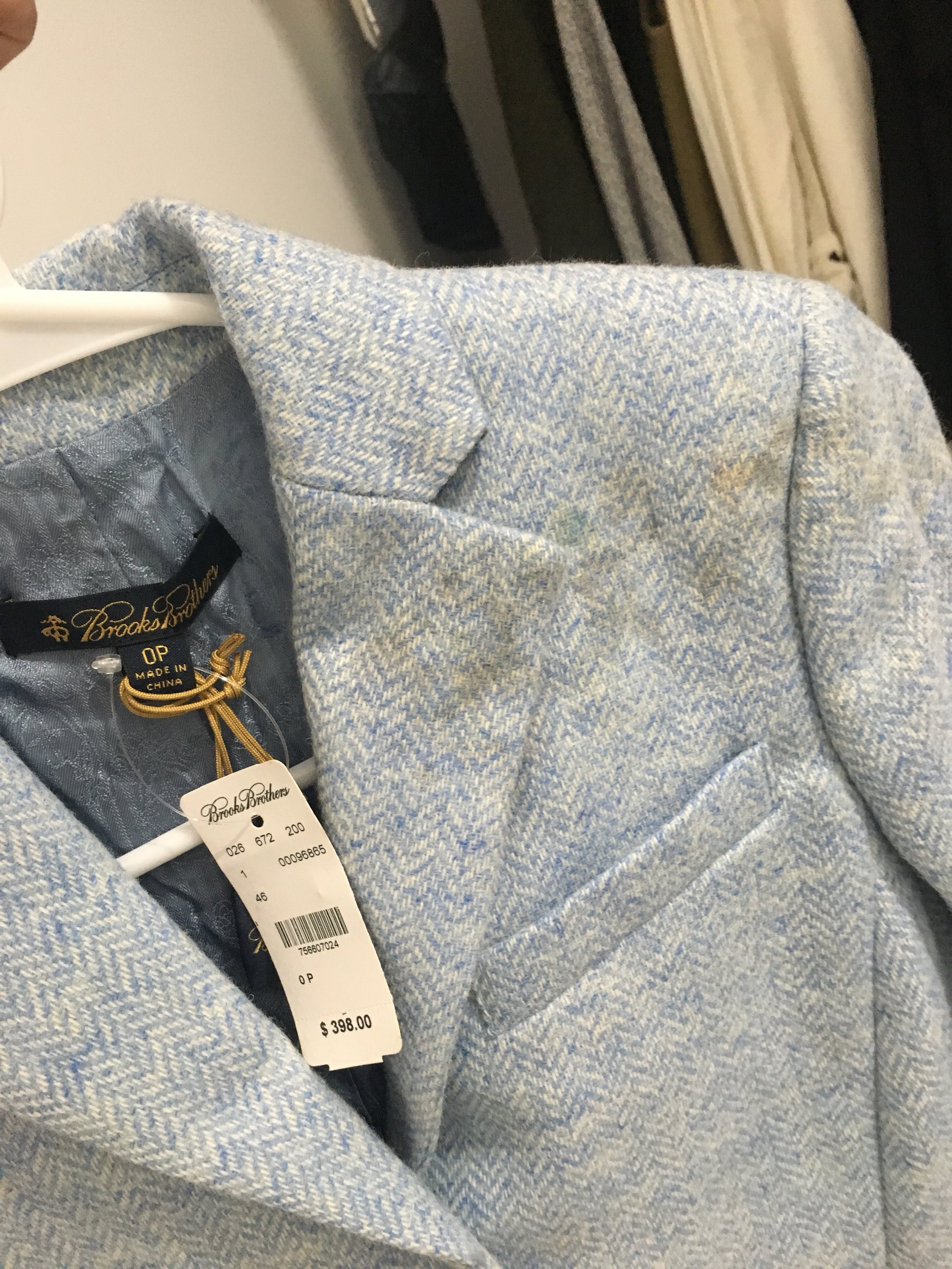 Lauren Pannell's Brooks Brothers blazer with damage.