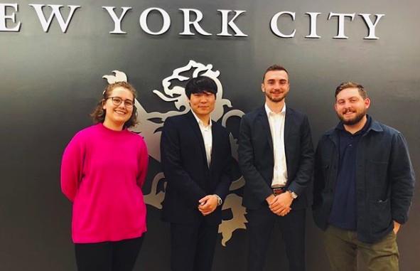 Co-founders of the Investments Club, Josh Kim and Michael Huber, stand in between the Director of Student Orgs Anna Wood and Student Body President Brandon Smith.    Photo credit to @tkccouncil instagram page.