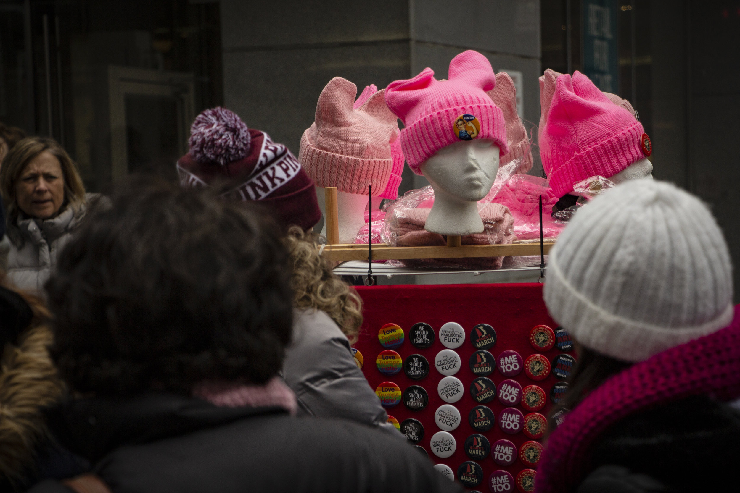 A stand of Women's March gear on 6th Avenue in NYC. || Photo credit to Bernadette Berdychowski