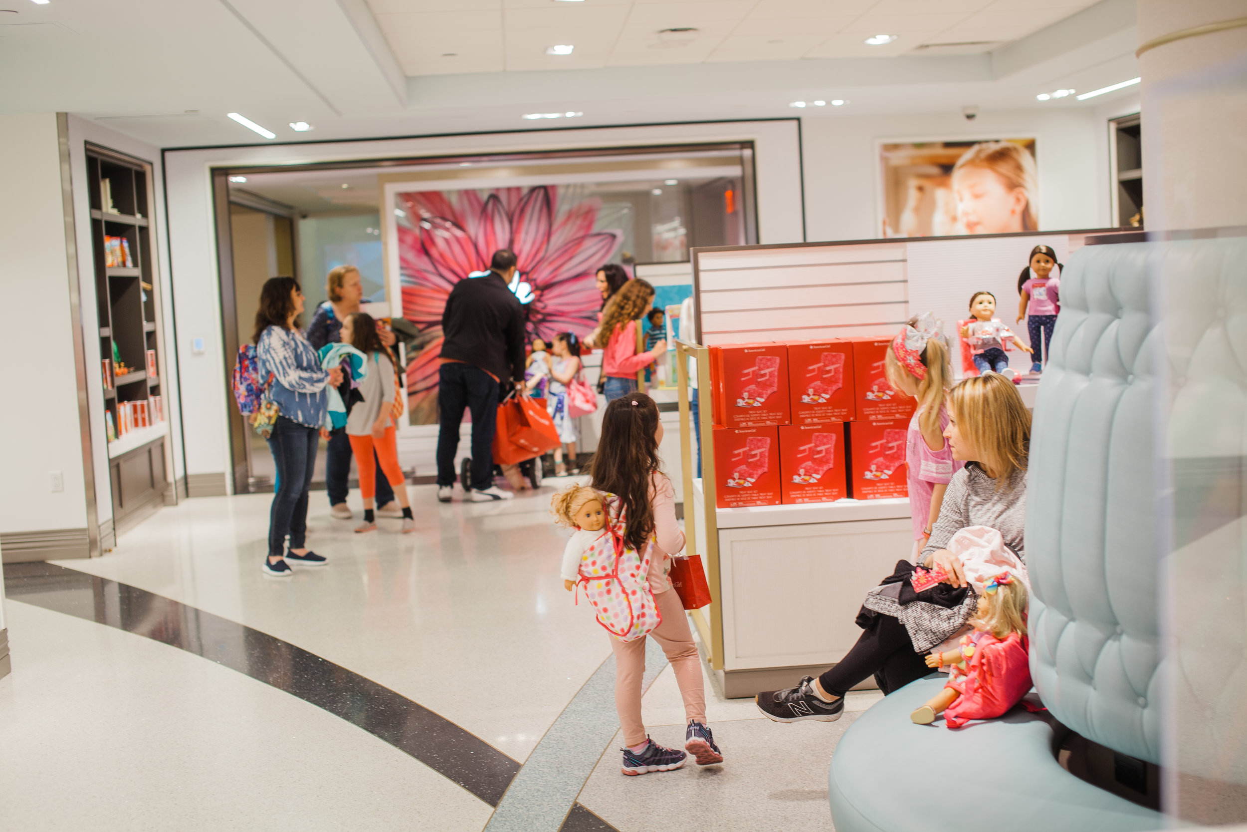 Visitors flood into the American Girl Store at 75 Rockefeller Plaza. || Photo credit to Eli Esher