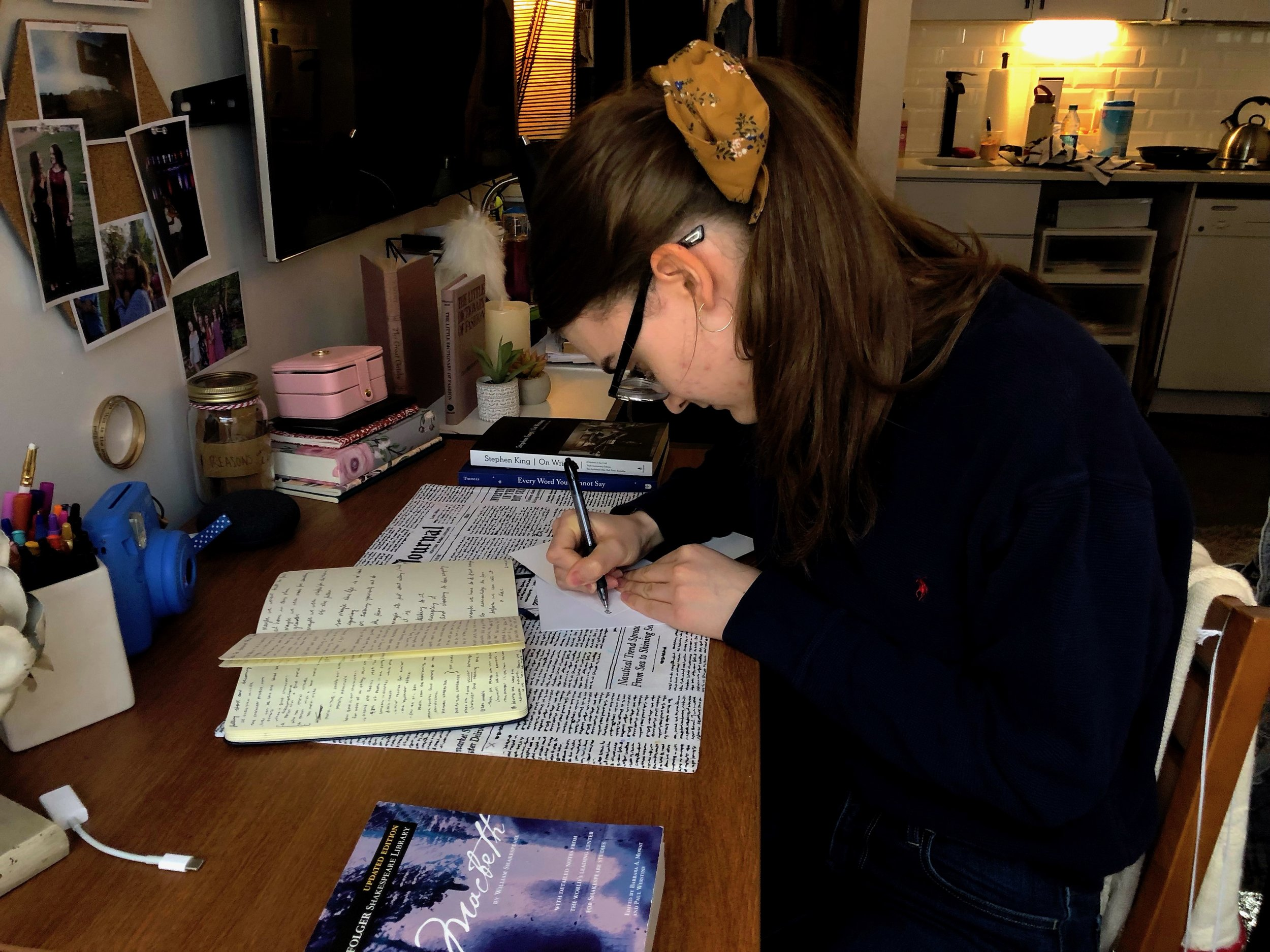 Ellen Coy writing a letter. || Photo credit to Lauren Bannister.