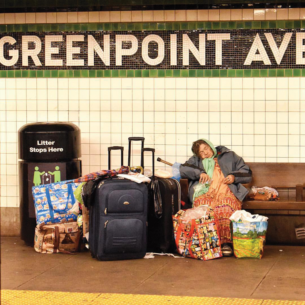 A homeless woman at the Greenpoint Ave. G train station in Brooklyn. || Photo credit to Jason Paris