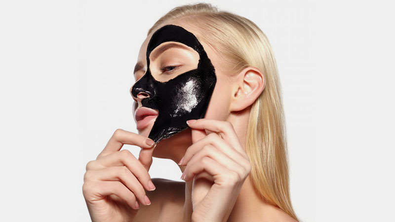 Activated charcoal face mask is used to reduce acne. I I Photo Credit to The Trend Spotter