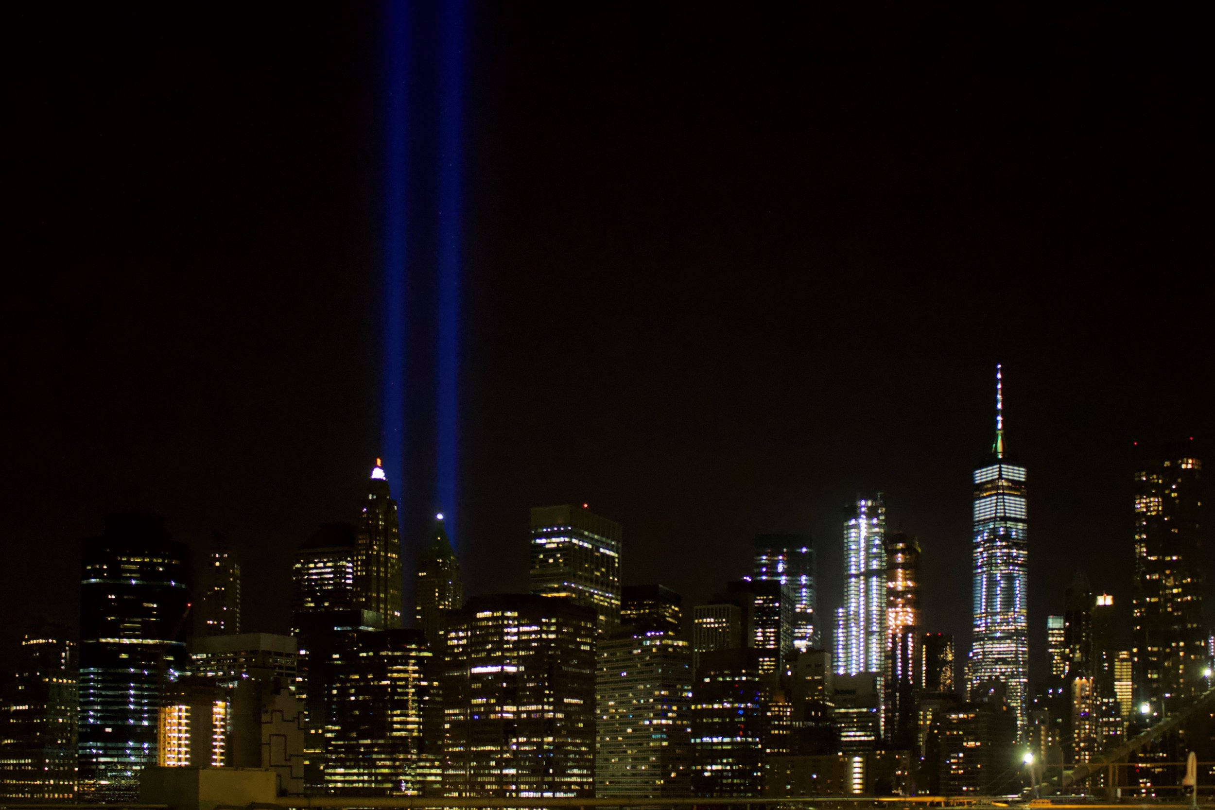 The Tribute in Light is an art installation of 88 searchlights placed six blocks south of the World Trade Center on top of the Battery Parking Garage in New York City to create two vertical columns of light to represent the Twin Towers in remembrance of the September 11 attacks. || Photo credit to Gabriela Kressley