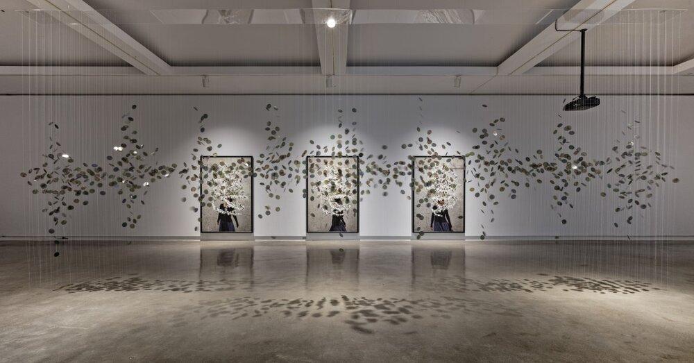 Hannah Claus, water song (2015) and Meryl McMaster, Murmur (2013) (Installation view at Robert McLaughlin Gallery 2018 Photographer: Toni Hafkenshied)