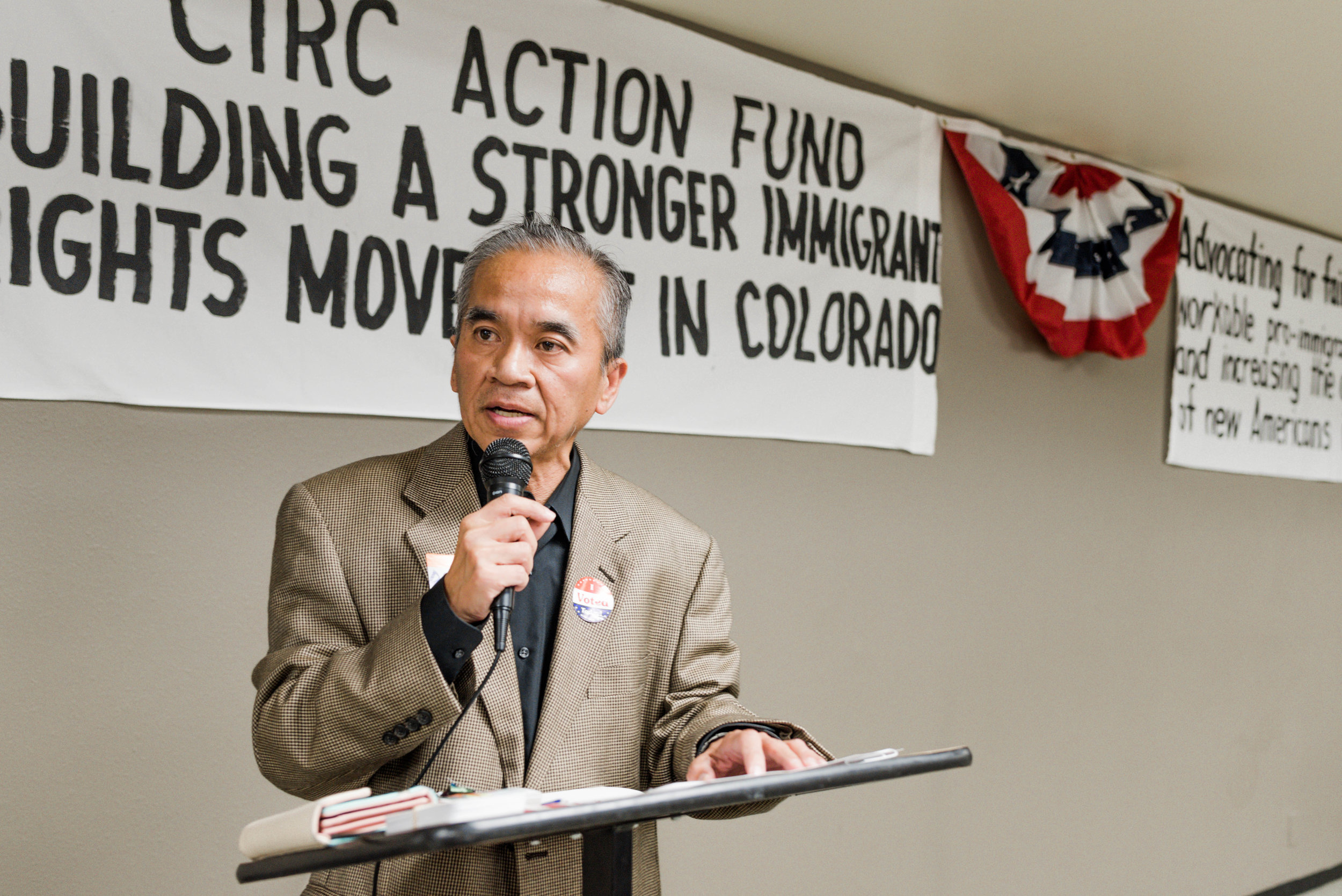 Leader of Team Colorado Springs, Dennis Apuan leads the election watch party.