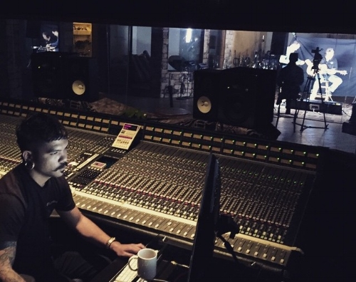Daniel Bourget behind the SSL console in Studio A