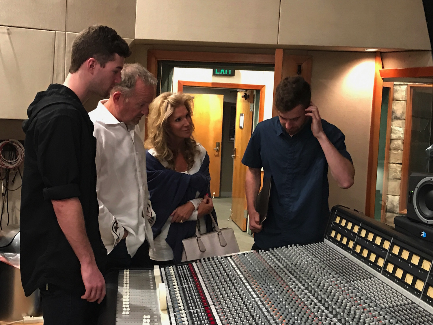 After the ceremony, Alex Boehnlein shows his parents and brother the SSL in the Studio A control room.