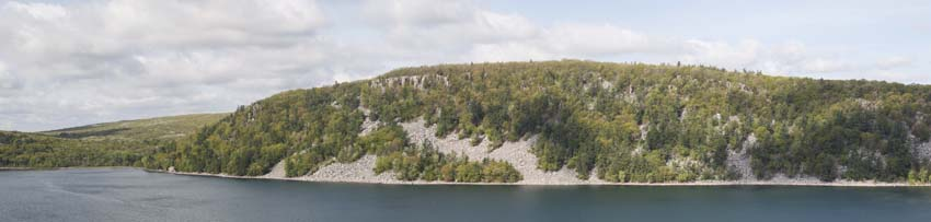 The tall cliffs of Prospect Point peek out atop the West Bluff of Devils Lake State Park.