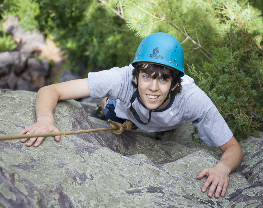 Seth Berger happily past the  intimidating crux of Pine Tree Step-Across (5.6)