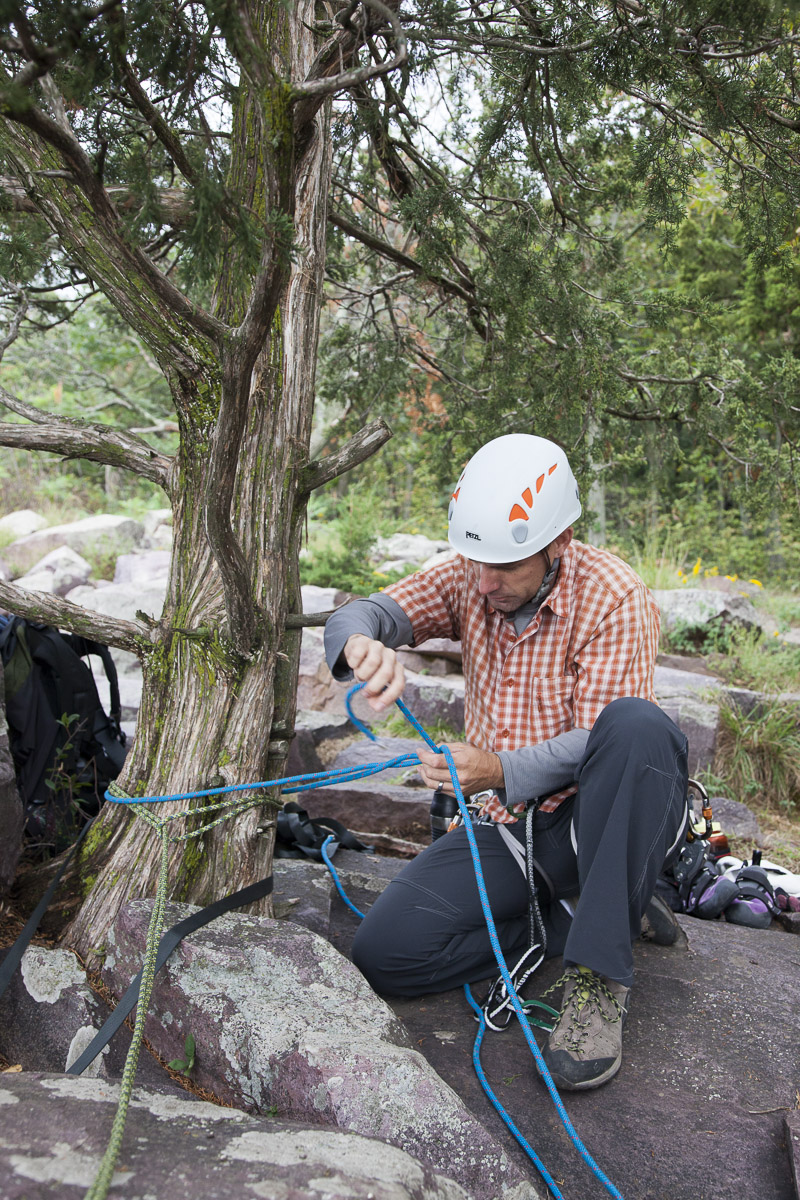 Jeremy ties a bowline with his static line