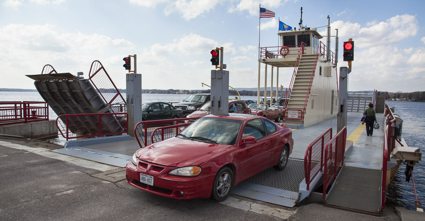 A car exits the Merrimac Ferry in Okee, WI