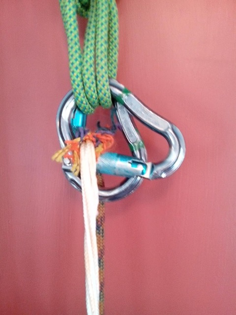 Climbing rope snags on carabiner gate.
