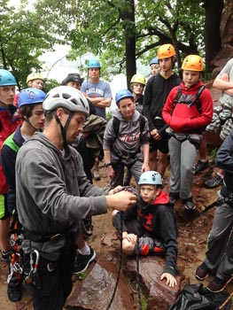 Kevin teaches a group of Boy Scouts how to tie a a Figure 8 follow-through knot.
