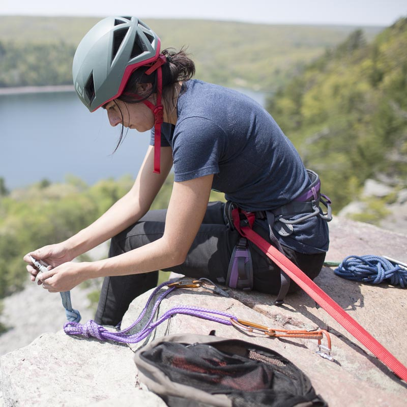 Aleeza builds a top-rope anchor on Angel Crack.