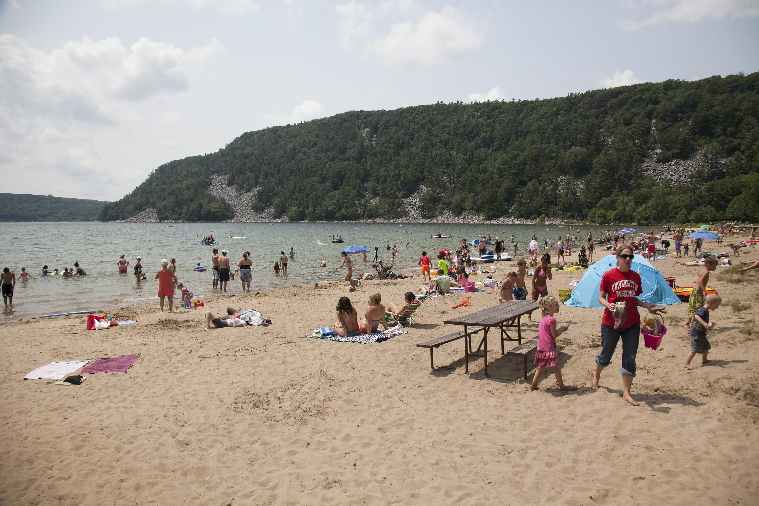 The sandy beaches are a main attraction on sunny days at Devils Lake State Park.