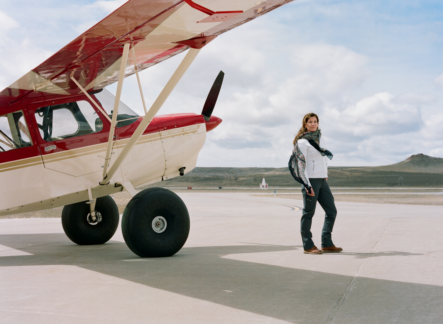 Lori Olson is a backcountry pilot, rural airstrip advocate, and director of the Upton Municipal Airport in Upton, Wyoming. Pictured here with 'Papa Charlie,' her American Champion 7GCGC high country plane.