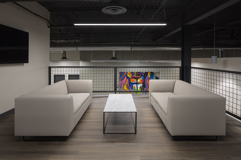 Two sofas and a coffee table provide an area to relax while waiting for a meeting.