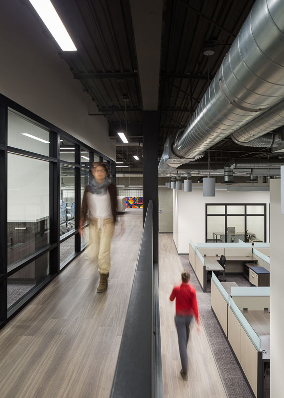 Here you can see the two separate levels in the office. The conference rooms are on the mezzanine level, and the workstations and offices are on the first level.