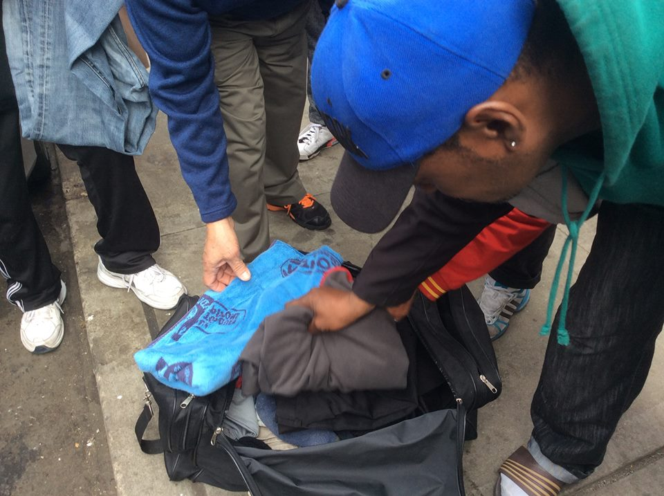 Men receiving donations.jpg
