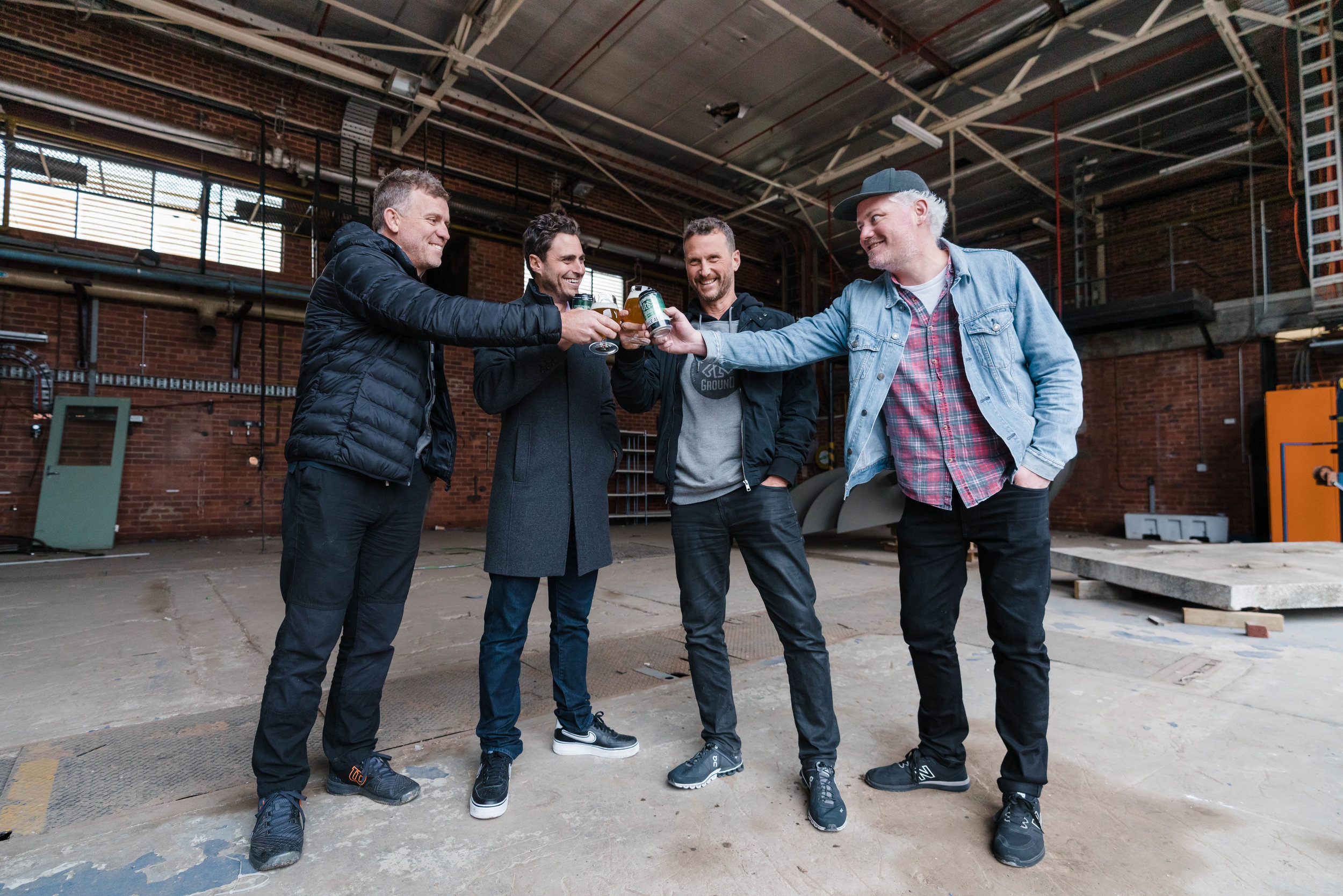 Steve, Guy and Justin toast the announcement of Stomping Ground Morris Moor with Up Property Managing Director Adam Davidson (second from left).