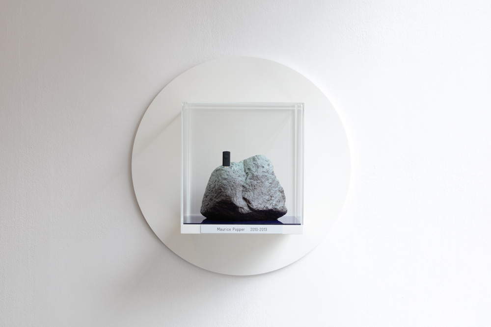 Face Book,  2017 Plaster stone, display case, wood, acrylic glass ∅ 60 cm x 30 cm