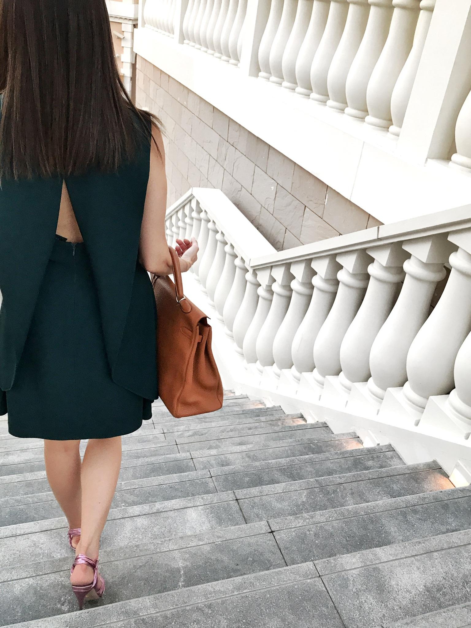 The Look: open-back dress, Gucci shoe, Hermés Kelly -