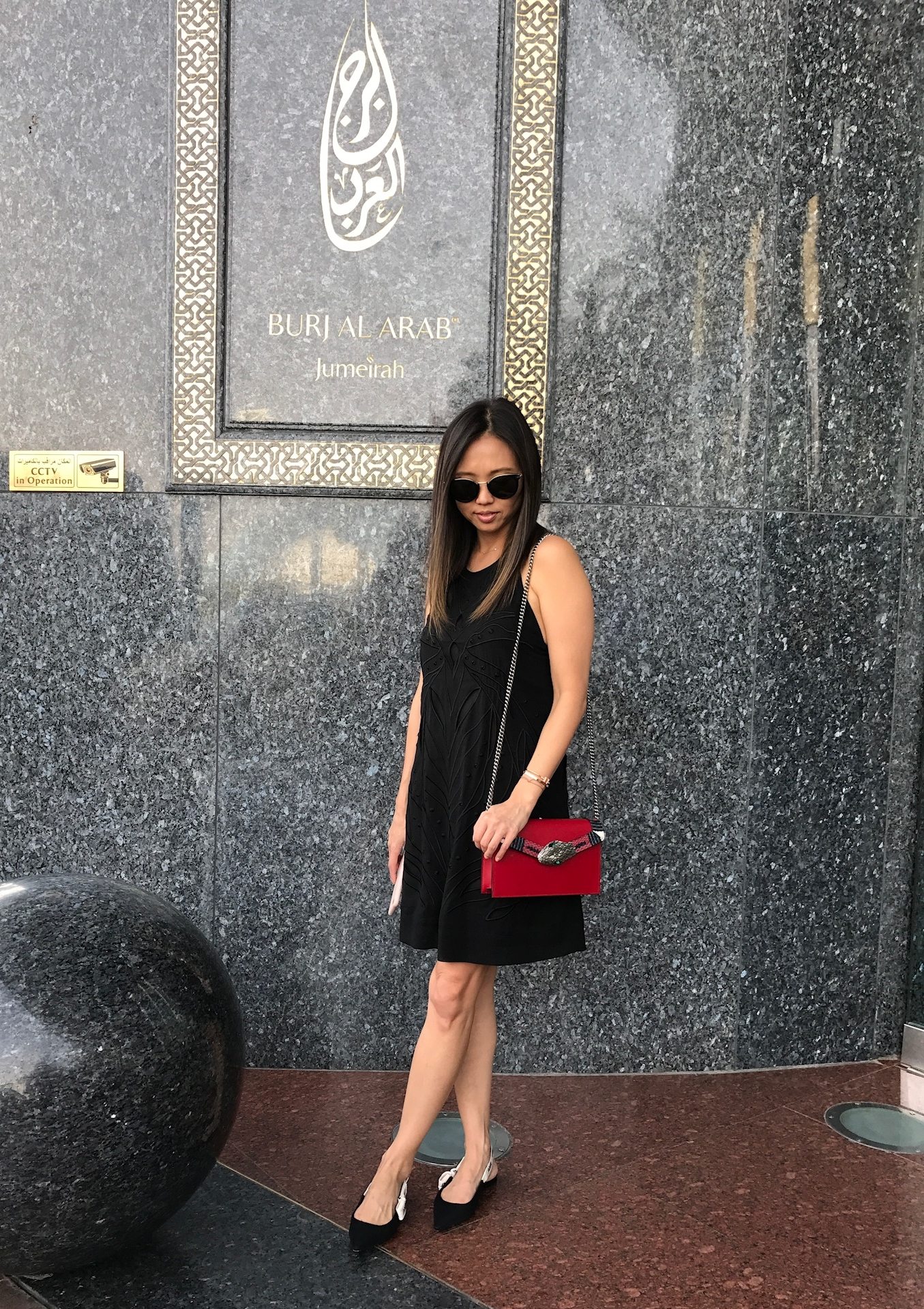 The Look: LBD, Céline sunglasses, Gucci snake bag, Dior flats -