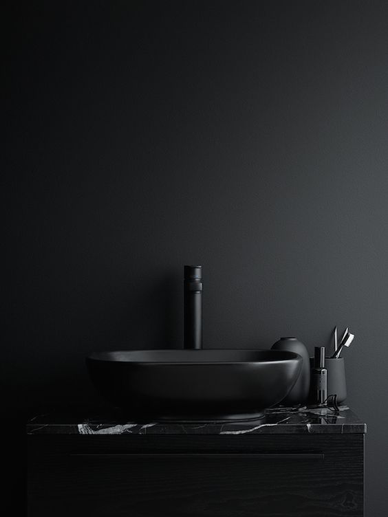 Matte black basin and marble top