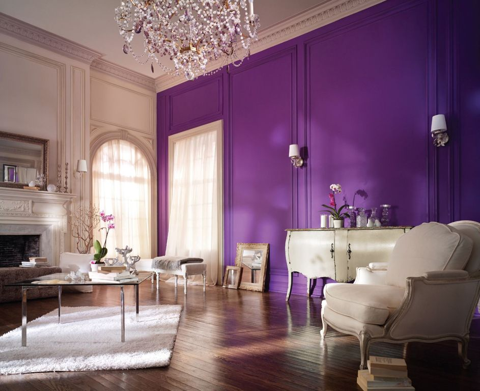 Classic-purple-lounge-room-interior-design-with-purple-painted-wall-also-glass-coffee-table-plus-white-armchair-on-laminate-wooden-floor.jpg