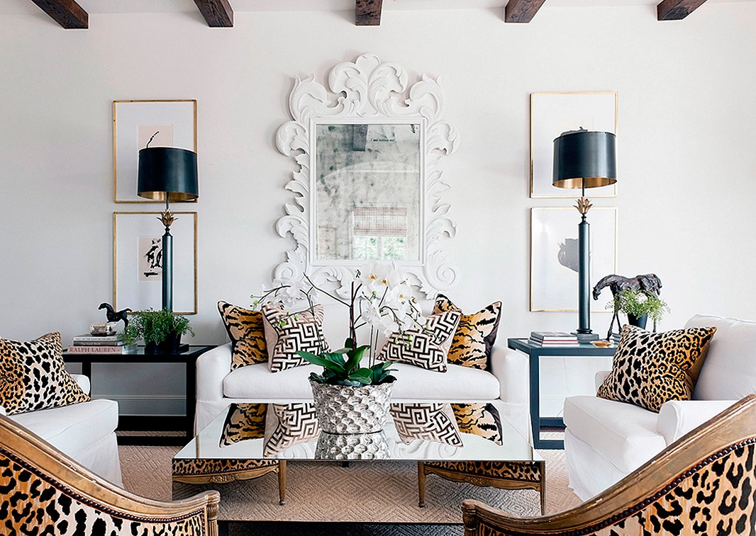 leopard and tiger print throw pillows bring an otherwise traditional living space to life!