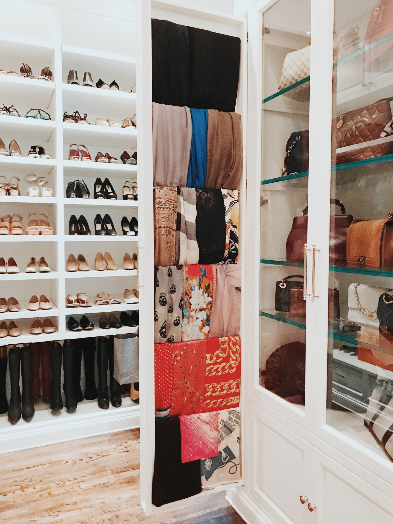 PULL-OUT CABINETS  -- IT MAY SEEM LIKE A SIMPLE SOLUTION, BUT A PULL-OUT CABINET CAN BE A CREATIVE WAY TO STORE ANY COLLECTION WITHOUT EATING UP VALUABLE REAL ESTATE IN THE CLOSET!
