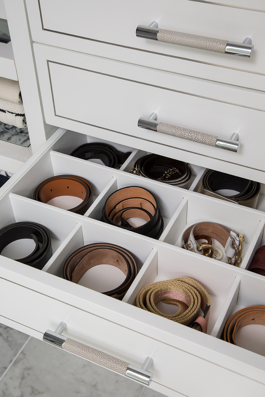 belt cubbies keep your buckles looking new, and everything untangled!