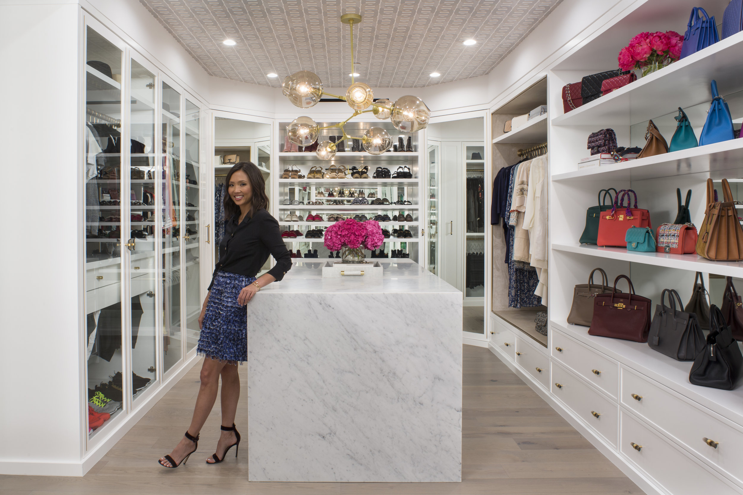 DON'T FORGET TO VOTE FOR THIS COLORFUL COLLECTOR'S CLOSET AS YOUR CONTEMPORARY DESIGN FAVORITE AT LUXEMAGAZINE.COM!