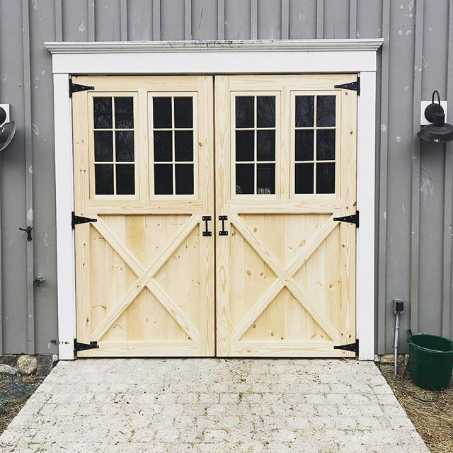 Double swinging door on an well-loved barn. The stone walk adds a perfect touch! #barndoors #barndepot #handcrafted #madeinmassachusetts #madeinnewengland #wooddoors